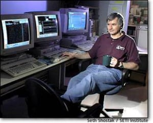 SETI astronomer Seth Shostak puts his feet up in the control room of ...