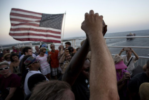 hands as a show of unity as thousands of marchers meet in the middle ...