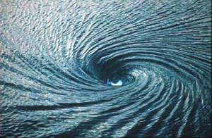 Watch a video of Twin Whirlpools in Australian Floodwaters:
