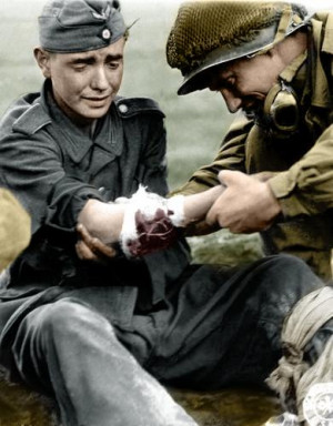 American helping wounded German soldier , 1944 . Army Sur geon General ...