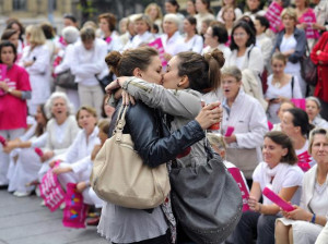Lesbian couple kisses in front of a anti-gay protest in France.