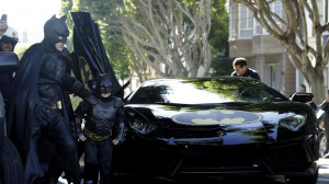 left, exits the Batmobile with Batman to save a damsel in distress ...