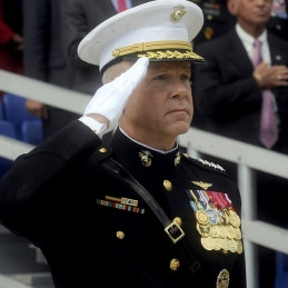 The Commandant of the Marine Corps, General James F. Amos saluting