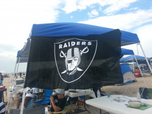 raiders flag making its first appearance at a raiders event