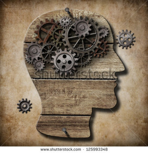 Human brain work metaphor made of rusty metal gears - stock photo
