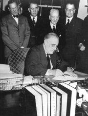 President Franklin D. Roosevelt signs the declaration of war against ...