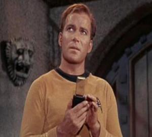 Captain Kirk using his tricorder in the TV series Star Trek