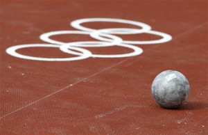 shot put is seen on the ground during the men's shot put ...