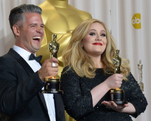 Adele Adkins and and Paul Epworth hold the Best Original Song Award ...