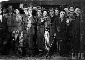 Margaret Bourke-White: Hollow-eyed male prisoners stare through barbed ...