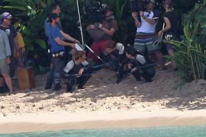 Catching Fire' Quarter Quell pics: Katniss, Peeta, Finnick on a ...