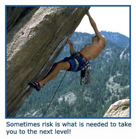 Male climber taking a risk climbing up steep rock!