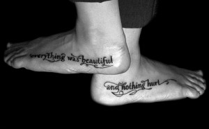 Feminine Quote And Black Circle Tattoo On Forearm