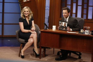 Amy Poehler laughs with the audience as she is interviewed by Seth ...