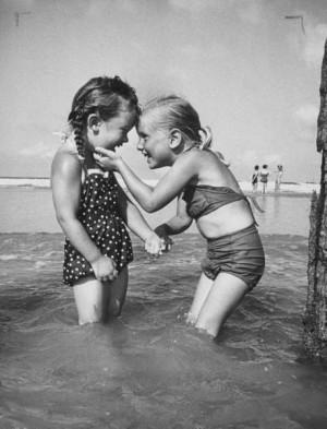 Lisa Larsen, Little girls playing together on a beach, Atlantic Beach ...