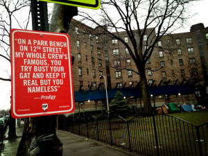 ... specific street art with official-looking signs bearing hip hop lyrics
