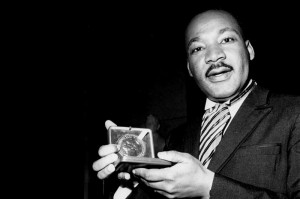 Martin Luther King, Jr. with the Nobel Prize for Peace in 1964