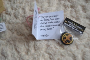 Madge gave everyone a Mockingjay button pin, to keep our spirits up.