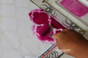 Once the entire pillow cover was painted, Natalie peeled back the ...