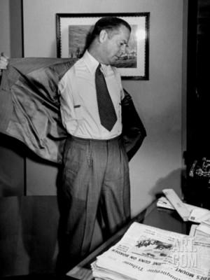 Columnist Westbrook Pegler Taking Off His Jacket to Begin His Workday