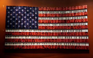flag bearing a quote about immigration by President George W. Bush ...