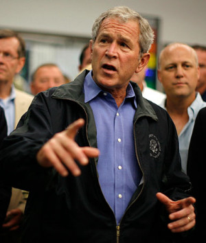 President George W. Bush speaks to a room of emergency workers ...