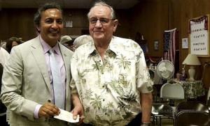 Congressman Ami Bera presents a check to VGP Founder Jim Rounsavell