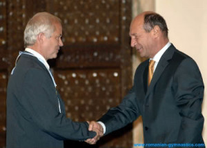 Adrian Goreac (left) receives a presidential distinction in 2007 ...