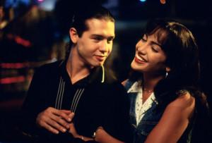 Jennifer Lopez as Selena Quintanilla and Jon Seda as Chris Perez