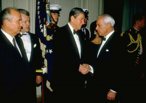 President Ronald Reagan greets Paul Nitze as he arrives at the White