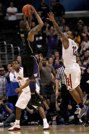 Isaiah Thomas #2 of the Washington Huskies makes a last-second shot in ...