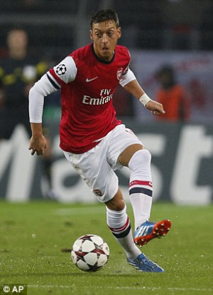 ... Mesut Ozil (left) but did attempt to sign Aaron Ramsey (right) for