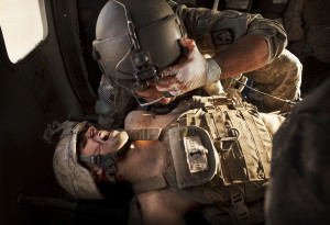 flight medic SGT Jaime Adame, top, cares for seriously wounded Marine ...