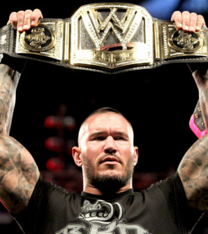 Randy Orton holding his gold
