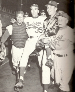 Roy Campanella and a young Don Drysdale carry Maglie off the field on ...