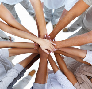 Closeup of business people standing with hands together