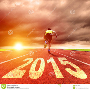 Stock Photo: Happy new year 2015. young man running with sunrise