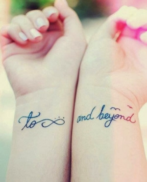 Quotes tattoos and infinity tattoos on wrist of girl