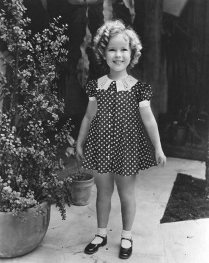 Shirley Temple wearing one of her classic outfits.