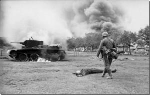 German infantryman walks toward the body of a killed Soviet soldier ...