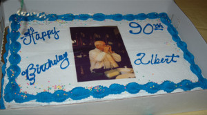 ... playing his beloved harmonica was placed on his 90th Birthday cake