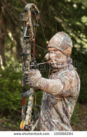 stock-photo-bow-hunter-in-camouflage-pulling-bow-back-closeup ...