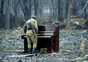 Russian Soldier playing abandoned piano in Chechnya