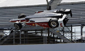 The car driven by Helio Castroneves, of Brazil, is airborne after ...