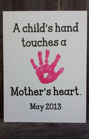 ... on a canvas with vinyl quote-A Child's hand touches a Mother's heart