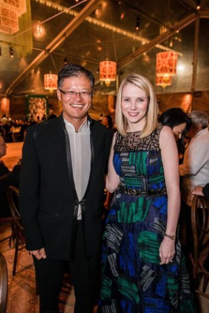 Yahoo co-founder Jerry Yang and CEO Marissa Mayer attend an exhibit at ...