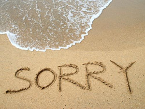 Sorry written on sand on beach