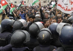 Jordanians protest outside the Israeli embassy in the capital of Amman ...