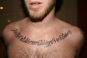 ... with sharp angles gives an edgy look to this urban chest quote tattoo