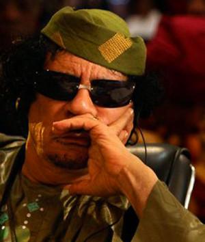 Muammar Gaddafi, the Libyan leader, questioning whether it should be ...